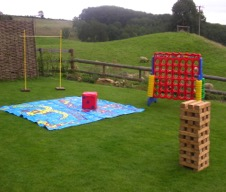 giant jenga hire, giant connect four hire, limbo and giant snakes and ladders are ideal wedding day lawn games to hire.