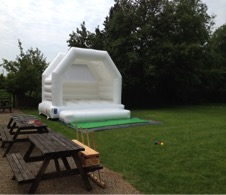 Bouncy castles to hire for weddings | white castle to hire  in Gloucester, Tetbury, Kingscote, Stroud and the Cotswolds