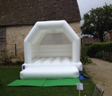 Pristine white bouncy castle available from Cheltenham bouncy castle man Dale Corry