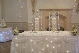 add a little sparkle to your wedding day with these fairy light table skirts for hire from Gloucestershire venue dressers ~ all about fun uk.com