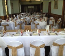hire chair covers in white, black or ivory for your wedding day at rendcomb college, Cirencester.